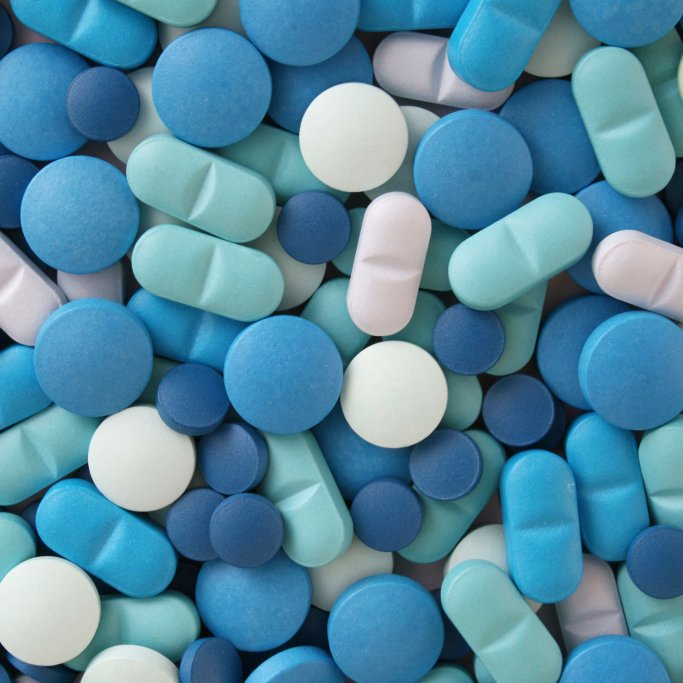 Top view of many types of blue pills